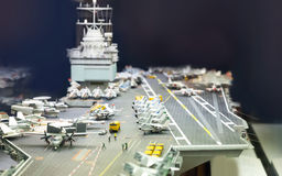 Miniature model of aircraft carrier. Miniature model of aircraft carrier on black background stock photo