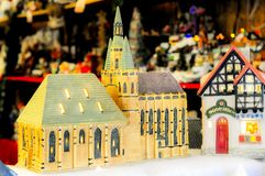 Miniature model church at  a Christmas market Royalty Free Stock Image