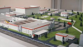 Miniature model of the factory. Clip. A small building on the toy model stock image