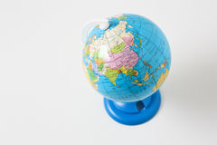 Miniature model of the globe. In isolation Stock Image