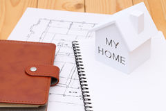 Miniature  model of house. And blueprints, construction plan Stock Image