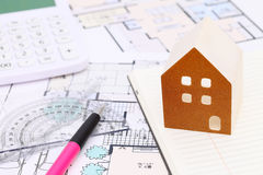 Miniature  model of house and blueprints. Construction plan Stock Photography