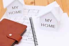 Miniature  model of house. And blueprints, construction plan Stock Photos