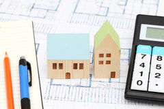 Miniature  model of house on blueprints. Construction plan Royalty Free Stock Image