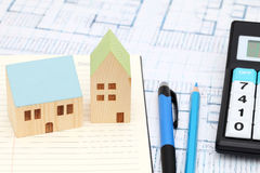 Miniature  model of house and blueprints. Construction plan Royalty Free Stock Photos