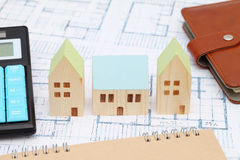 Miniature  model of house on blueprints. Construction plan Stock Photography