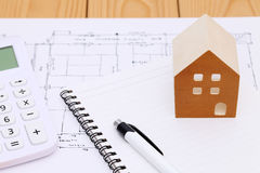 Miniature  model of house and blueprints. Construction plan Stock Images