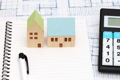 Miniature  model of house and blueprints. Construction plan Royalty Free Stock Photo