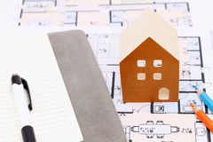 Miniature  model of house on blueprints. Construction plan Royalty Free Stock Images