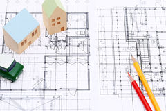 Miniature model of house on blueprints. Construction plan Royalty Free Stock Photography