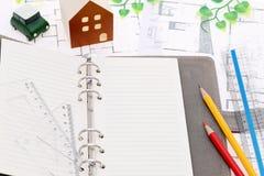 Miniature model of house on blueprints. Construction plan Stock Images