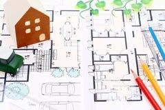 Miniature model of house on blueprints. Construction plan Stock Image