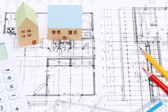 Miniature model of house on blueprints. Construction plan Royalty Free Stock Photo