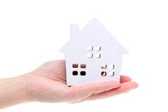Miniature model of house on the hand Royalty Free Stock Photo
