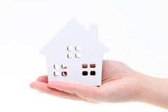 Miniature model of house on the hand. On white background Stock Photos