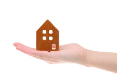 Miniature model of house on the palm. Isolated on white background Stock Image