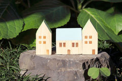 Miniature model of house. On stone in the garden Royalty Free Stock Photo