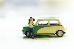 Miniature model man backpacker with car on map royalty free stock photos