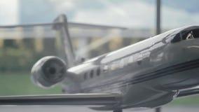 Miniature model of modern airplane stock footage