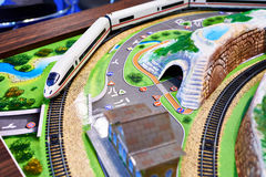 Miniature model of terrain with railway and train Royalty Free Stock Image