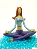Miniature model in a yoga position. Physical and mental exercises are designed to help achieve this goal, also called self-transcendence or enlightenment. On the Stock Photo