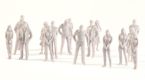 Miniature monochrome figures of human Royalty Free Stock Image