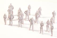 Miniature monochrome toys of human Royalty Free Stock Photos
