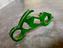 Miniature motorcycle keychain with bottle opener Stock Image