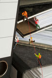 Miniature Mountaineers Climbing Office Files. Miniature models of mountaineers rope climbing up a set of randomly positioned files Stock Image