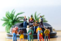 Musical band on stage with audience royalty free stock images