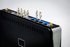 Miniature network engineers at work. Stock Photo