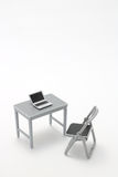 Miniature notebook PC,  office table and chair. Royalty Free Stock Images
