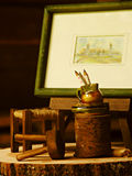 Miniature objects. Objects in miniature on a log Royalty Free Stock Images