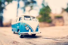 Miniature old fashioned vintage van on a countryside road. Macro photo royalty free stock images