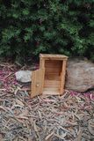 Miniature outhouse. A miniature outhouse made from recycled pallet wood Stock Image
