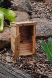 Miniature outhouse. A miniature outhouse made from recycled pallet wood Stock Photos