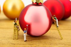 Miniature of painters and christmas balls royalty free stock image