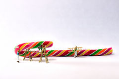 Miniature painters. That color a candy cane Royalty Free Stock Photography