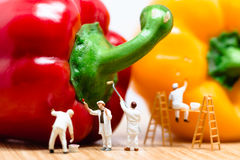 Miniature painters coloring bell pepper. Macro photo stock photo