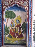 Miniature Painting. S This picture depicts Lord Krishna and his consort, Radha. It is an art popularized in the medieval period Stock Photography