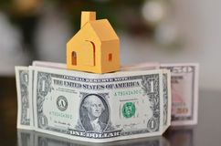 Miniature paper made house stand on  money Royalty Free Stock Photography