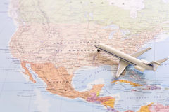 Miniature of passenger airplane on a map, travel destination USA Royalty Free Stock Image