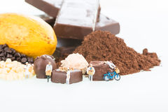 Miniature pastry chefs and cocoa. Over white background Royalty Free Stock Photos