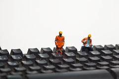 Miniature people in action on a computer keyboard Stock Image