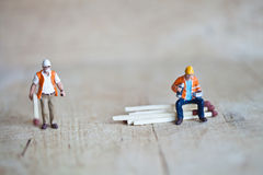 Miniature people in action with matchsticks Royalty Free Stock Photos