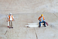 Miniature people in action with matchsticks Royalty Free Stock Image