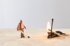 Miniature people in action with matchsticks Royalty Free Stock Photography