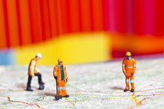 Miniature people in action on a roadmap. Miniature people in action in various situations Stock Images