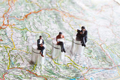 Miniature people in action on a roadmap. Miniature people in action in various situations Royalty Free Stock Images