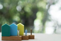 Free Miniature People Agent Sell Home Standing With Mini Home Stock Photos - 163655953